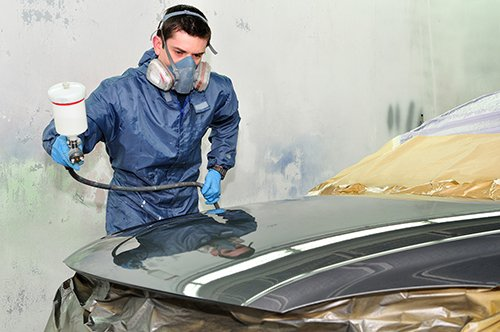 Worker spray painting a car may be exposed to isocyanates