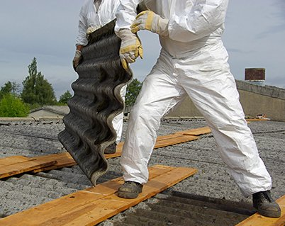 Worker moving asbestos sheets
